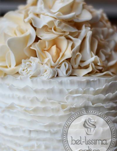 Close-up of Rose wedding cake with ruffle